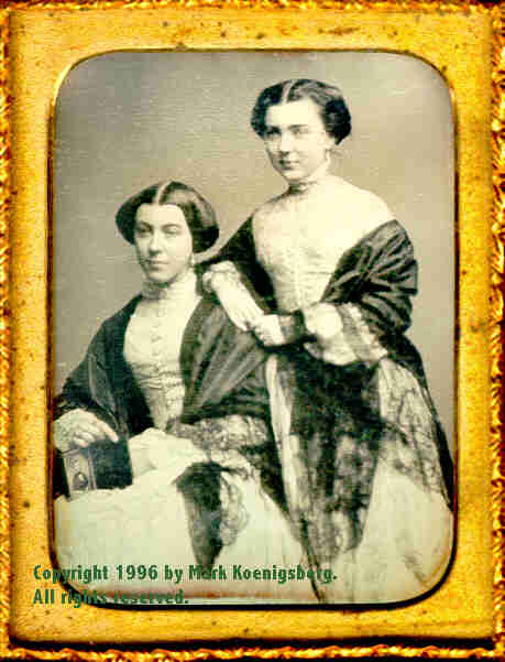 Quarter-plate daguerreotype of Two Pretty Women Holding a quarter-plate daguerreotype