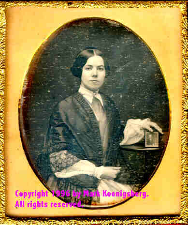 Sixth-plate daguerreotype of a Woman Holding a sixth-plate daguerreotype by Atkins