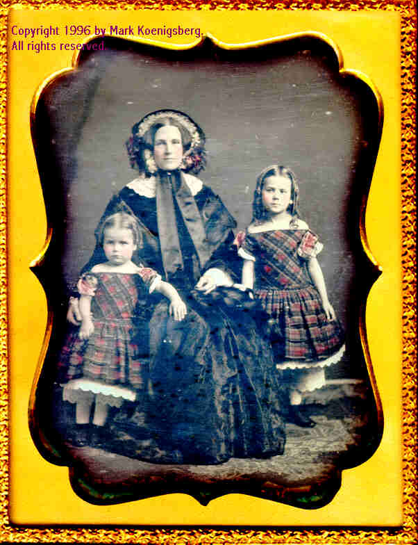 Half-plate daguerreotype of Mother and Two Daughters in Red