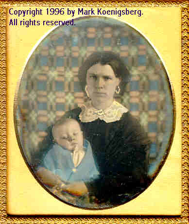 Sixth-plate daguerreotype of Mother and Baby with Blue Quilt